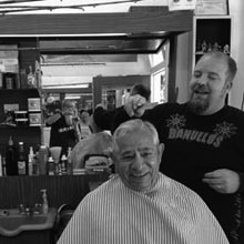 Barber Jon of Mike's Barber Shop cutting Mike's hair