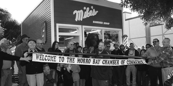 Barber Jon cutting the ribbon at Mike's Barber Shop Grand Opening Party